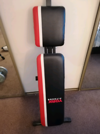 Almost brand new york weights bench & 1 inch weight plates and bars