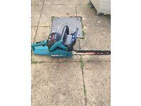Makitta 2 stroke petrol chainsaw with chain guard