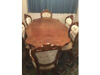 Dining table and 6 chairs including 2 carver chairs.