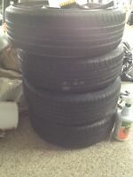 4 good 185/65/14 summer tires and 4 4x100 steel rims