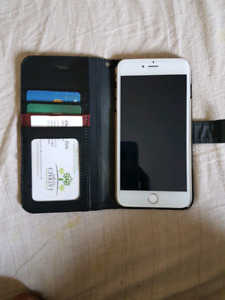 Gold iPhone 6plus and smart watch.