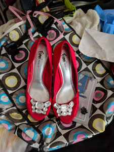 Ladies red, black or Coral coloured dress shoes.