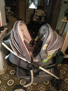 Stroller with car seat attachment with base for vehicle