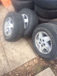 Two (2) Jeep Grand Cherokee rims with tires