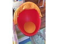 Swivel egg chair with flower cushion