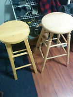 Two odd wooden stools