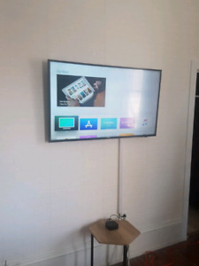 Installation TV au mur - Interac disponible