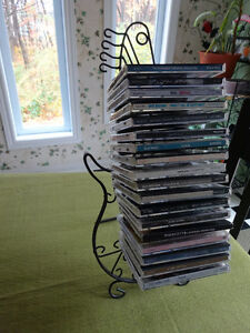 Metal guitar shaped CD/DVD rack (holds 18 cds)