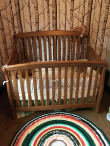 Solid oak crib with mattress, sheets +  protector like new