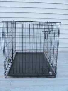 Metal animal crate 34 inches long x 19 h x 18 incheswide $68