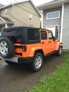 2012 Jeep Wrangler Sahara addition