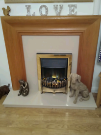 Oak fire surround with marble hearth and back plate