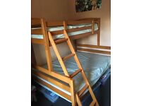 Double Bunk with single on top and ladder
