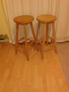 Two round-seat bar stools.