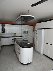 White Laminated Kitchen Cabinets and Countertop 1600$ negotiable