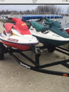 Two 1997 seadoos with double yacht club trailer