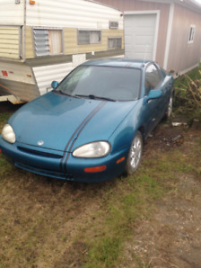 1993 Mazda MX-3, 4 cylinder , bodymans special! asking 1700$ obo