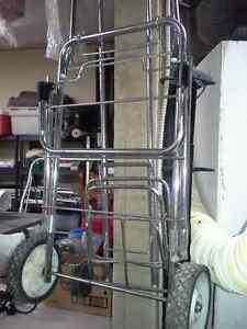 Assortment of two wheeled foldiing luggage carriers...