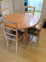 Bleached oak round dining table set with 4 chairs. Seats up to 6