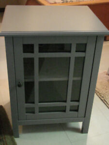 small end table with tempered glass in door
