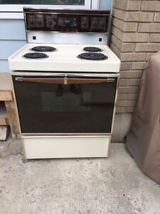 Almond colored Beaumark Self-cleaning stove