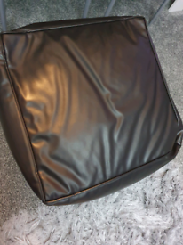 Brown pouffe footstool seat.