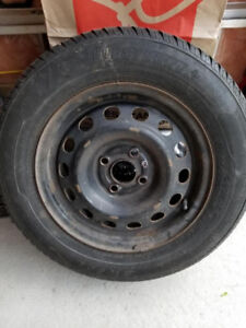 """F.S Set of 4 14"""" 185/70 R14winter rims and tires"""
