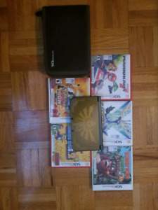 New Nintendo 3ds XL + 5 games and FREE traveling case