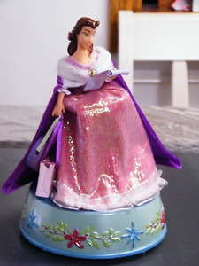DISNEY BELLE WITH BOOK SPINNING MUSICAL CHRISTMAS SONGS.