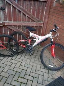 X2 reebok adult mountain suspension bikes