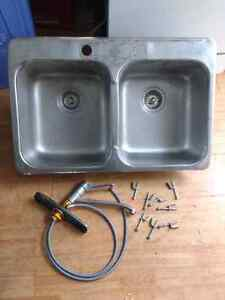 Stainless kitchen sink with MOEN faucet