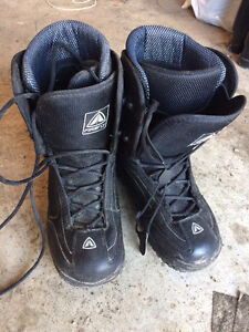 Two pairs of Firefly snowboarding boots size 10 and 11.5.