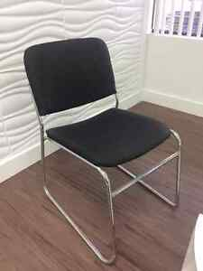 4 black chairs with silver legs