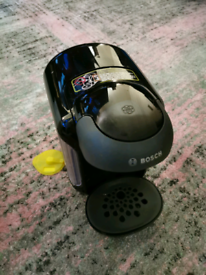 Black Tassimo Machine with cleaning disc