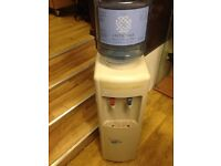Angel cooling water machine, small fridge at bottom