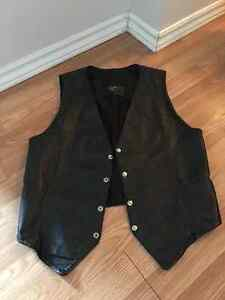 All leather vest front and back. Great for Halloween