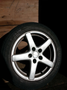 Set of 16 in wheels and tires for sale.