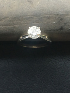 1.0 carat round cut engagement ring, $2,800