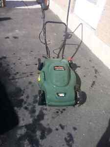 Electric lawn mower like new.