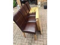 Oak dining table and 4 brown leather chairs