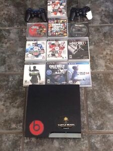 PS3 Console w 2 controllers and 10 games