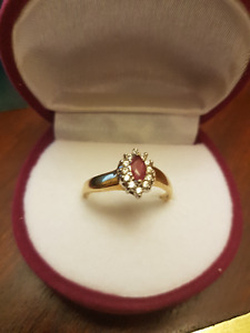 Reduced for quick sale: gold ladies diamond/ruby ring
