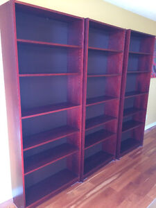 Three IKEA Billy bookcases, beautiful red brown/mahogany colour.