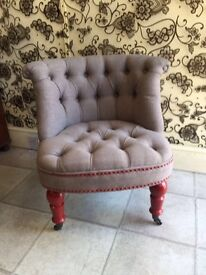 Grey Chesterfield style button back chair