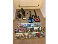 Xbox 360 250gb bundle with two guitar hero guitars and 23 games