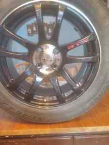 4x 4 bolt 205/55r16 rims and tires