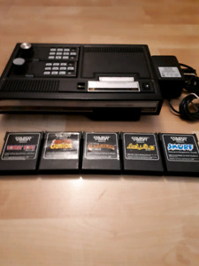 Colecovision console with 5 games. Video games