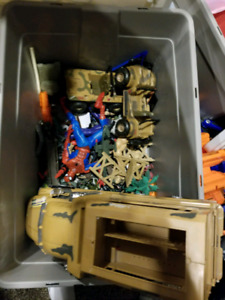A big bin of army men and army vehicles