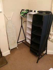 Ikea rack with shelves and clothes