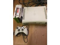 Xbox 360 with controller and 4 games